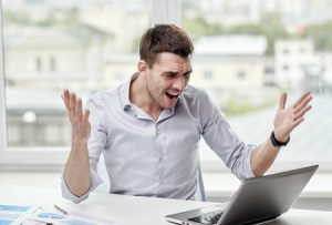 Businessman Angry at PC Wondering How to Repair Your Online Reputation