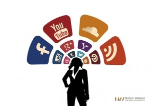 a silhouette of a businesswoman with social media icons above her head