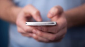 User Looking at Mobile Device Social Media