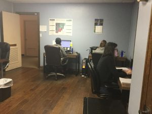 Employees In Office Performing Moving Company PPC Services