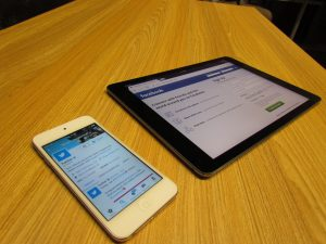 Mobile Twitter & Tablet Facebook Signifying Moving Company Social Media Marketing